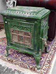 Sale 8939 - Lot 1010 - French Green Enamelled Cast Iron Stove, model Siroco, with glass panel front & side door. H: 64 W: 47 D: 32cm