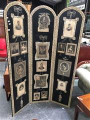 Sale 8666 - Lot 1001 - Black Decoupage Dressing Screen, of three arched top panels, mounted with engravings of European art & nobility