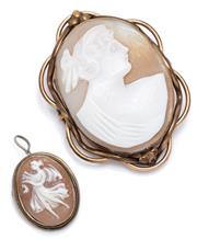 Sale 9083 - Lot 305 - TWO VINTAGE SHELL CAMEO BROOCHES; one carved with a classical portrait set in a scalloped gilt frame, 50 x 38mm, other of dancer set...