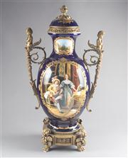 Sale 8660A - Lot 26 - A Continental Sevres style parcel gilt painted porcelain lidded urn featuring renaissance figures in an interior and serene landscap...