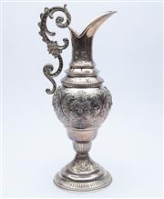 Sale 8414A - Lot 40 - A Viennese silver ewer with repousse floral decoration, marked 900 Austro Hungarian, H 36cm, weight approx: 844g