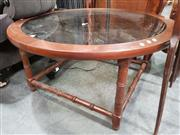 Sale 8688 - Lot 1095 - Round Glass Top Coffee Table
