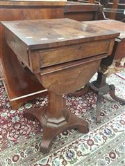 Sale 8917 - Lot 1024 - Regency Rosewood Work Table, with cross-banded top, a fitted and false drawers to the sides, with curved basket drawer below, on fac...