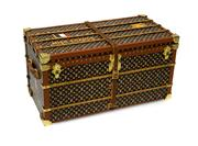 Sale 8406A - Lot 62 - French Louis Vuitton trunk novelty paper weight modelled after a steamer trunk, small wear to leather strap, 16 x 8 x 8 cm