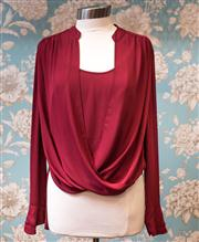 Sale 8474A - Lot 37 - A stylish BCBG MaxAzria blouse in merlot, excellent condition, size L