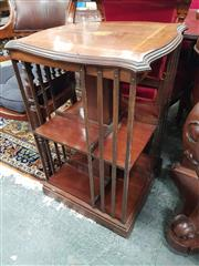 Sale 8868 - Lot 1073 - Edwardian Inlaid Mahogany Revolving Bookcase, of two tiers, the top with bat-wing medallion and satinwood banding