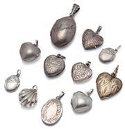 Sale 9046 - Lot 379 - ELEVEN SILVER LOCKETS; 6 x heart shape, 15-19mm, 4 x oval, 14 x 11-26 x 17mm and a clam shell 14.5 x 15mm, total wt. 32.76g.