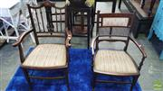 Sale 8390 - Lot 1087 - Two Similar Late Victorian Inlaid Mahogany Armchairs with spindel backs and padded seats.