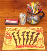 Sale 9058H - Lot 44 - A large quantity of swizzle sticks including Zulu Lulu and shell topped picks