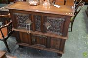 Sale 8500 - Lot 1076 - Gothic Style Carved Oak Cabinet, the Doors Carved with Tracery and Linen Fold Panels