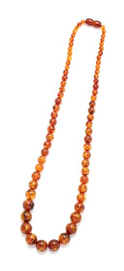 Sale 9246J - Lot 307 - A GRADUATED AMBER BEAD NECKLACE; 4.5 -11mm round reconstituted amber beads to screw clasp, length 49cm.