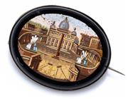 Sale 8982 - Lot 373 - AN ANTIQUE ITALIAN MICRO MOSAIC BROOCH; featuring St Peters Basilica within an onyx surround set in white metal, size 38 x 30mm, min...
