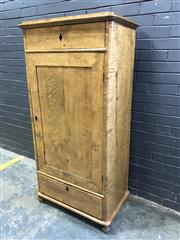 Sale 9048 - Lot 1003 - Biedemeier Small Wardrobe, possibly fiddle birch or maple, with slight stepped top, single panel door, with a drawer above & below (...
