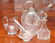 Sale 9058H - Lot 46 - A cut glass oil pourer with a hallmarked silver cap together with a vinegar bottle and stopper and two small sauce jugs and spoon