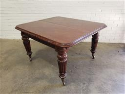 Sale 9097 - Lot 1096 - Early Victorian Mahogany Extension Dining Table, without leaves, raised on turned carved legs with brass castors (h:76 x w:138 x d:1...