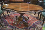 Sale 8390 - Lot 1038 - Unusual Early Victorian Rosewood Loo Table with serpentine shape top on an inverted octagonal pedestal on unusual upswept upturned f...