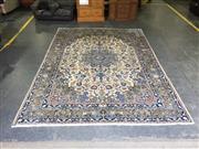 Sale 9031 - Lot 1052 - Large Nain or Qum Wool Carpet, with blue-green medallion & pendants on a cream arabesque field (296 x 397cm)