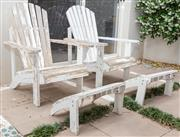 Sale 8644A - Lot 9 - A pair of weathered white painted Adirondack chairs with matching foot stools.