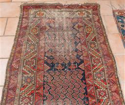 Sale 9120H - Lot 66 - An antique possibly Kurdish wool carpet with repeated boteh and serrated leaf border, 220cm x 108cm  (worn)