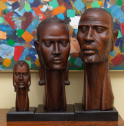Sale 8677B - Lot 531 - Three carved timber busts, male and female on square plinth bases, both signed I KOLI,  tallest, 63cm