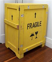 Sale 8990H - Lot 84 - A yellow painted and stencilled cabinet fashioned from a packing crate with single door and internal shelf, Height 96cm x Width 70cm...
