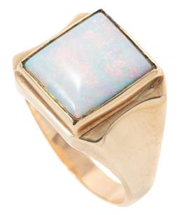 Sale 9149 - Lot 390 - A GENTS VINTAGE 9CT GOLD OPAL SIGNET RING; featuring a rectangular cabochon solid opal (13.13 x 11.06mm) of good colour display (sc...