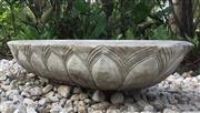 Sale 8706A - Lot 22 - A large carved stone planter with lotus petal motif, general wear, some chipping, slight crack, H 21 x L 100 x W 48cm