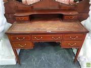 Sale 8634 - Lot 1066 - Late Victorian Inlaid Mahogany Desk, with brass gallery back & two trinket drawers, a tooled brown leather top, five drawers & taper...