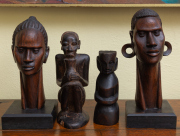 Sale 8677B - Lot 528 - A pair of two timber African busts of male and female together with two smaller tribal carvings, tallest 25cm