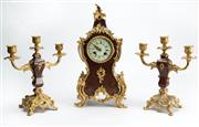 Sale 8444A - Lot 10 - A Louis XV style faux tortoiseshell clock and garniture set, the clock with gilt metal mounts and the face with roman numerals and s...