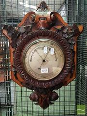 Sale 8539 - Lot 1018 - Victorian Carved Oak Barometer, of shield form, the leaf capped bezel flanked by growing vines