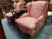 Sale 8634 - Lot 1074 - Pair Louis XV Style Wingback Armchairs, upholstered in a rose fabric with flowering branches & pomegranates, carved aprons & cabriol...
