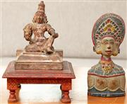Sale 8976H - Lot 65 - A carved hindu female deity with an associated red timber stand and a carved painted oriental bust (missing hand) Tallest 115cm