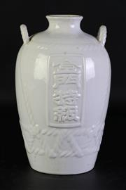 Sale 8972 - Lot 48 - White glazed Chinese vase with roped motif and featuring central dragon (H25cm)