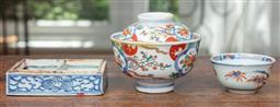 Sale 9120H - Lot 71 - A small group of Chinese and Japanese wares including an early blue and white brush washer, tea bowl and a lidded bowl, Length of in...