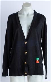 Sale 9003F - Lot 83 - A Yves Saint Laurent twin set in black knit comprising a T shirt and cardigan with gold buttons to front, both size L