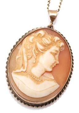 Sale 9149 - Lot 354 - A VINTAGE 9CT GOLD CAMEO PENDANT; oval carved shell cameo portrait of a lady to gold frame with wire twist decoration, size 40 x 26m...