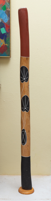 Sale 8677B - Lot 532 - A handpainted didgeridoo on stand, L x 144cm