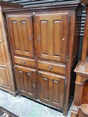 Sale 8976 - Lot 1088 - Early 19th Century French Oak Kitchen Cabinet, with four short panelled doors & two central drawers. (H:180 x W:123 x D:57cm)