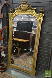 Sale 8500 - Lot 1065 - Late 19th Century French Eclectic Style Mirror, Surmounted by a Cartouche and Urns &  within a Scale Boarder Frame