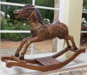 Sale 8677B - Lot 535 - A timber carved rocking horse width H x 115cm, W x 58cm (some breaks)
