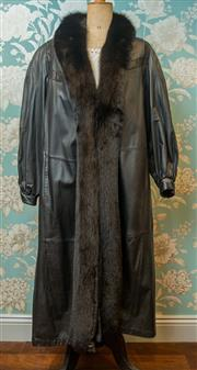 Sale 8420A - Lot 73 - A rare LeMonti New York women's leather trench coat with lama fur trim, size: L, condition: as new