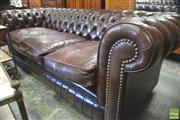 Sale 8390 - Lot 1013 - Three Seater Chesterfield Lounge, with buttoned back and pleats in chestnut