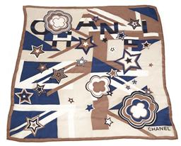 Sale 9115 - Lot 351 - A CHANEL SILK SCARF; blue, fawn and black pattern on a cream ground, machined edge, size 67 x 67cm.