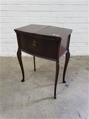 Sale 9085 - Lot 1054 - 1920s Sewing Cabinet, the two door top revealing a blue fabric lined interior, raised on cabriole legs (h:70 x w:50 x d:33)