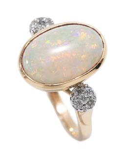 Sale 9213 - Lot 382 - AN 18CT GOLD OPAL AND DIAMOND RING; bezel set with a 13 x 10mm oval cabochon (approx. 3.6ct) solid white opal of good colour display...