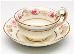 Sale 9246 - Lot 7 - A handpainted and gilded 19th century Coalport cup and saucer - unmarked (Dia:14.5cm)