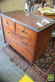 Sale 8335 - Lot 1089 - Victorian Mahogany Campaign Chest of Four Drawers, with recessed brass handles & raised on turned legs (chip to top corner)