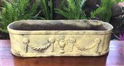 Sale 8706A - Lot 24 - A large cream colour cast iron oval planter with roman urn motif, H 15 x L 59cm