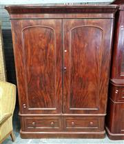 Sale 8976 - Lot 1077 - Victorian Flame Mahogany Wardrobe, with two arched panel doors, enclosing hanging, slides and drawers, with two further drawers belo...